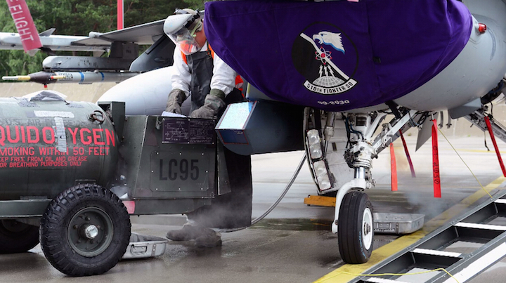 A nuclear-capable F-16C/D Block 40E (hull number 89-4030) of the 510th (Buzzards) Fighter Squadron from the 31st Fighter Wing at Aviano AB in Italy is serviced at Lask AB in Poland in July 2014.