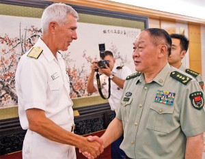 PACOM Commander Admiral Samuel Lochlear, seen here shaking hands with Chinese defense minister Liang Guanglie in Beijing in 2012, says that China may be building up to eight ballistic missile submarines.