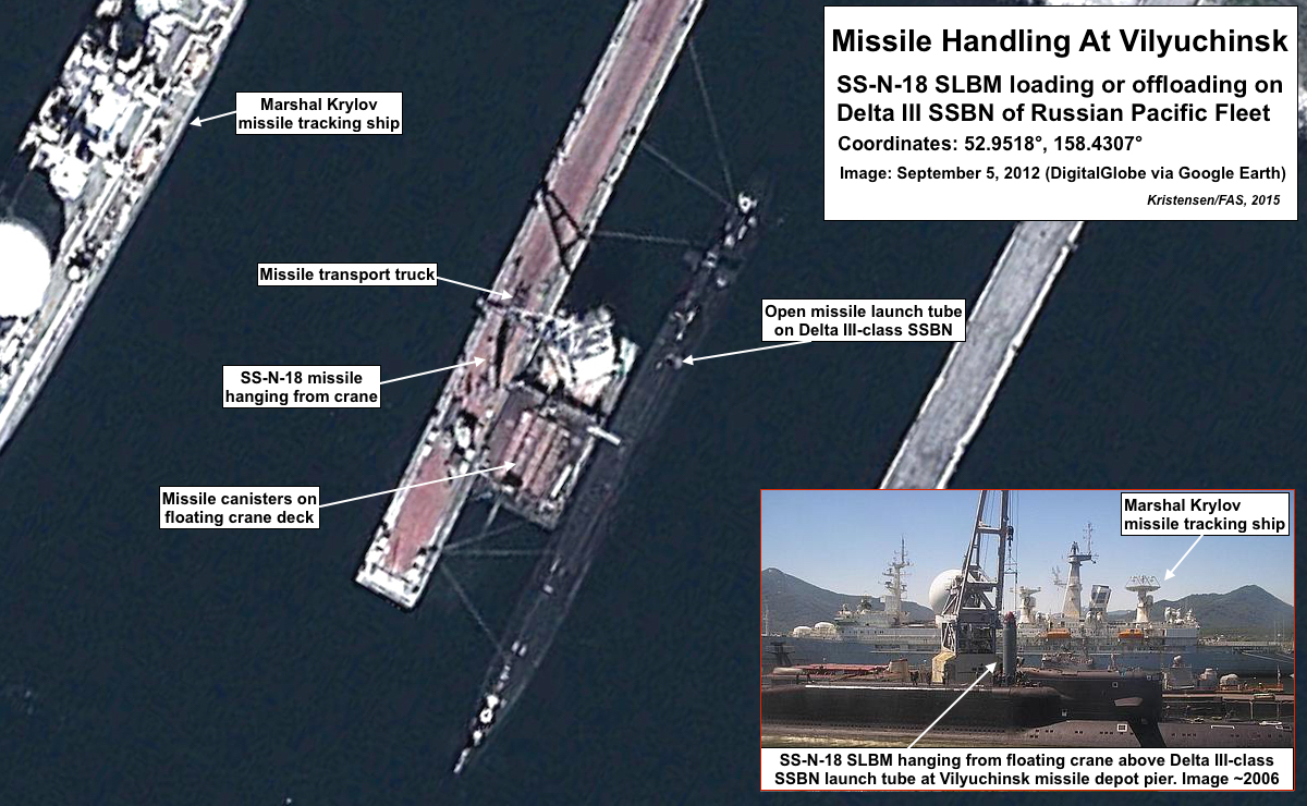 SS-N-18 handling at Vilyuchinsk missile loading pier. Click to see full size image.