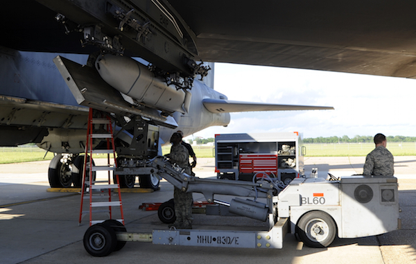A JASSM-ER is loaded onto the wing pylon of a B-52H bomber at Barksdale AFB during STRATCOM's Global Lightning exercise in May 2014.