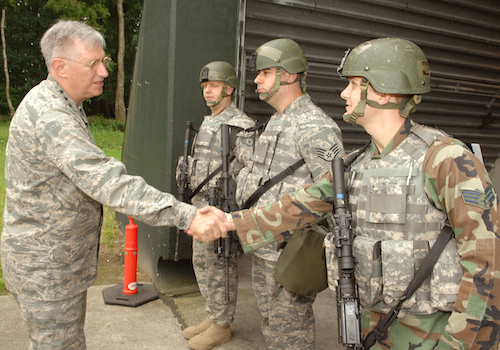 Former US Air Force Europe commander General Rodger Brady shakes hands with 703 Munitions Support Squadron personnel at Volkel Air Base in June 2008 during security upgrades to U.S. nuclear weapons storage sites in Europe. More expensive security upgrades are planned.